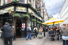 People and exterior of pub, for drinking and so Royalty Free Stock Photography