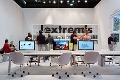 People at Extremis stand during Salone del Mobile, Milan Stock Photo