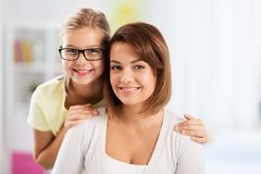 Portrait of happy mother and daughter at home royalty free stock photo