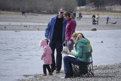 People , family resting on the river walk, talk Stock Images