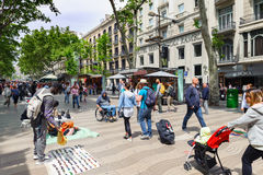 People at famous La Rambla street in center of Barcelona town. Royalty Free Stock Photos