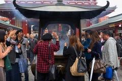 people fan incense smoke at Sensoji temple Royalty Free Stock Photos