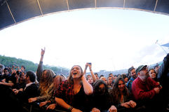 People (fans) scream and dance in the first row of a concert at Heineken Primavera Sound 2013 Festival Stock Images