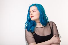 People and fashion concept - Young woman with choker and blue hair posing over white background.  royalty free stock photo