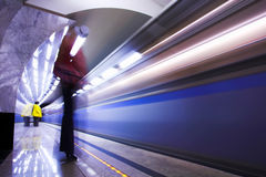 People and fast train in subway Stock Photography