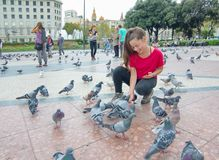 People feeding the pigeons in Catalonia Plaza, Barcelona Royalty Free Stock Image