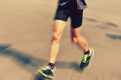 People feet on city road in marathon running race Stock Photography