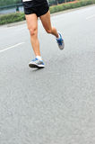 People feet on city road in marathon running race Royalty Free Stock Images