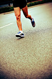 People feet on city road in marathon running race Stock Images