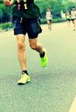 People feet on city road in marathon running race Stock Photography