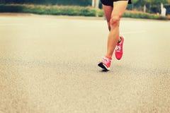 People feet on city road in marathon running race Stock Photo