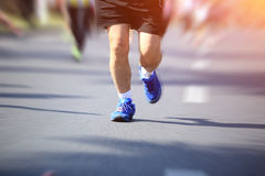 People feet on city road in marathon running race Royalty Free Stock Image