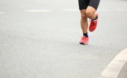 People feet on city road in marathon running race Stock Image