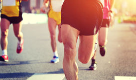 People feet on city road in marathon running race Royalty Free Stock Photography