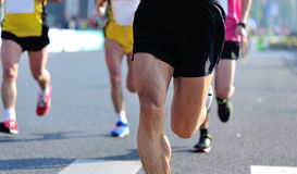 People feet on city road in marathon running race Royalty Free Stock Photos