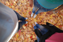 People Feet Standing on Autumn Leaves Royalty Free Stock Images