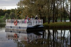 People on the ferry in Catherine park, St. Petersburg, Russia. Pushkin, St. Petersburg, Russia - September 20, 2015: People on the historical ferry on the Grand Royalty Free Stock Photos
