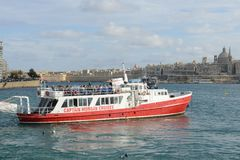 People on the ferry leading to La Valletta on Malta. La Valletta, Malta - 2 November 2017: people on the ferry leading to La Valletta on Malta Royalty Free Stock Photos