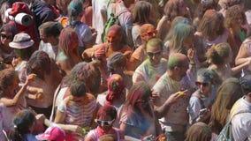People at  Festival de los colores Holi in Barcelona stock footage