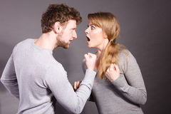 People in fight. Young couple arguing. Negative emotions concept. People in fight. Husband and wife arguing and yelling on each other. Expressive and emotional stock images
