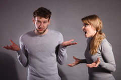 People in fight. Young couple arguing. Negative emotions concept. People in fight. Husband and wife arguing and yelling on each other. Expressive and emotional royalty free stock images