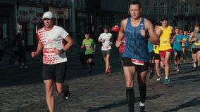 People are fighting for the championship in the marathon running. LVIV, UKRAINE - OCT 13, 2019: A large number of people are fighting for the championship in the stock video footage