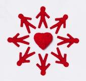 People figures around yarn heart stock images