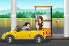 People filling up gasoline at the gas station. A vector illustration of a young woman  filling up gasoline at the gas station Royalty Free Stock Photos