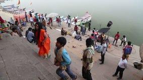 People filming video at ghat by Ganges in Varanasi. stock footage