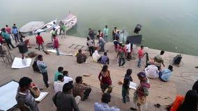People filming video at ghat by Ganges in Varanasi. stock video