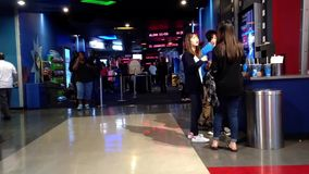 People finding entrance of movie at cinema stock video footage