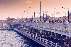 People fish from the Galata bridge on August 24, 2013 in Istanbu Stock Photo