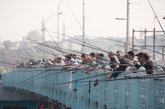 People fish from the Galata bridge, Istanbul stock photos