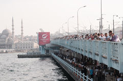 People fish from the Galata bridge, Istanbul Royalty Free Stock Photo