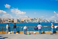 People fish near the Galata bridge Istanbul on August 24, 2013 Royalty Free Stock Images
