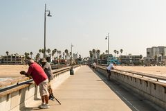 People Fish on Venice Beach Fishing Pier in Southern California Royalty Free Stock Image
