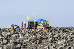 People at a fishermans hut Royalty Free Stock Photo