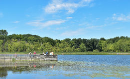 People on a fishing dock Royalty Free Stock Photos