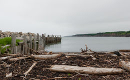 People fishing at the end of a dock in Springtime. Nova Scotia coastline in June. Stock Image