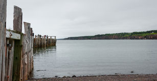 People fishing at the end of a dock in Springtime. Nova Scotia coastline in June. Stock Photo