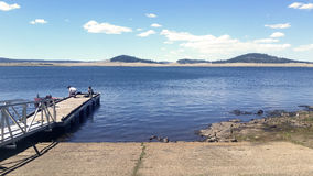 People fishing and enjoying the day in one of the multiple lakes of the regi. Pinetop / Lakeside, Arizona, circa Memorial day 2016. People fishing and enjoying Royalty Free Stock Photos