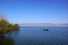People fishing on Erhai lake, Dali, Yunnan province, China Royalty Free Stock Photo