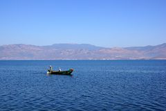 People fishing on Erhail lake, Dali, Yunnan province, China Stock Image