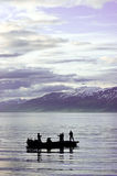 People fishing on fjord Stock Images