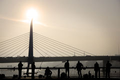 People fishing on Galata Bridge Stock Images