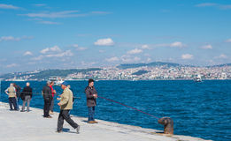 People fishing in istanbul Stock Photos