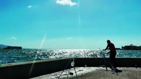 People Fishing near the Sea. Video stock footage