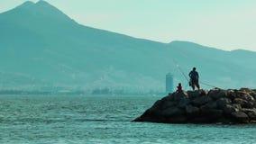 People Fishing near the Sea. Video stock video footage