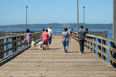 People on fishing pier Stock Image