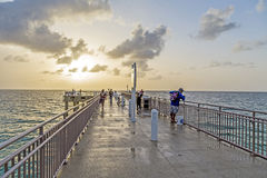 People at fishing Pier in Sunny Stock Images